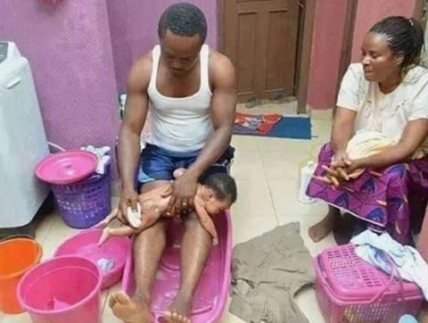 So Cute!  Nigerian Man Pictured Bathing His Newborn Baby (Photo)