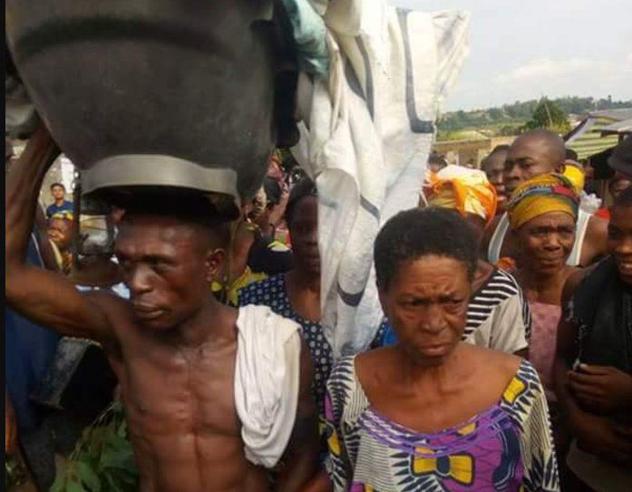 Old Woman Made To Dance Publicly For Having Sex With A Young Man In Ebonyi (Photos)