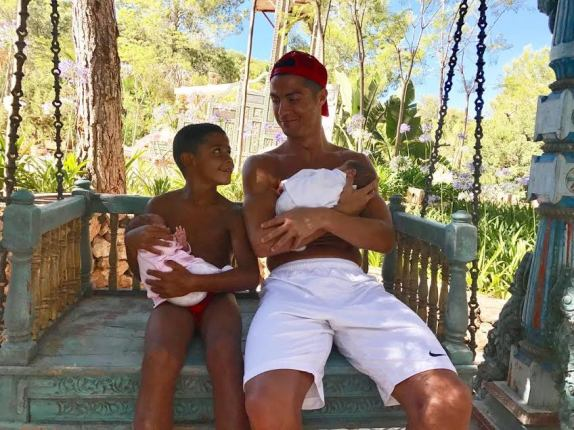 Cristiano Ronaldo & His 7-year-old Son Cuddle His Newborn Twins in New Family Photo