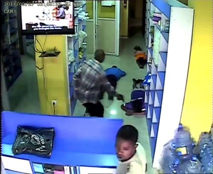 Nigerian Man Shares CCTV Images Of Armed Robbers Robbing His Pharmacy Store On Twitter