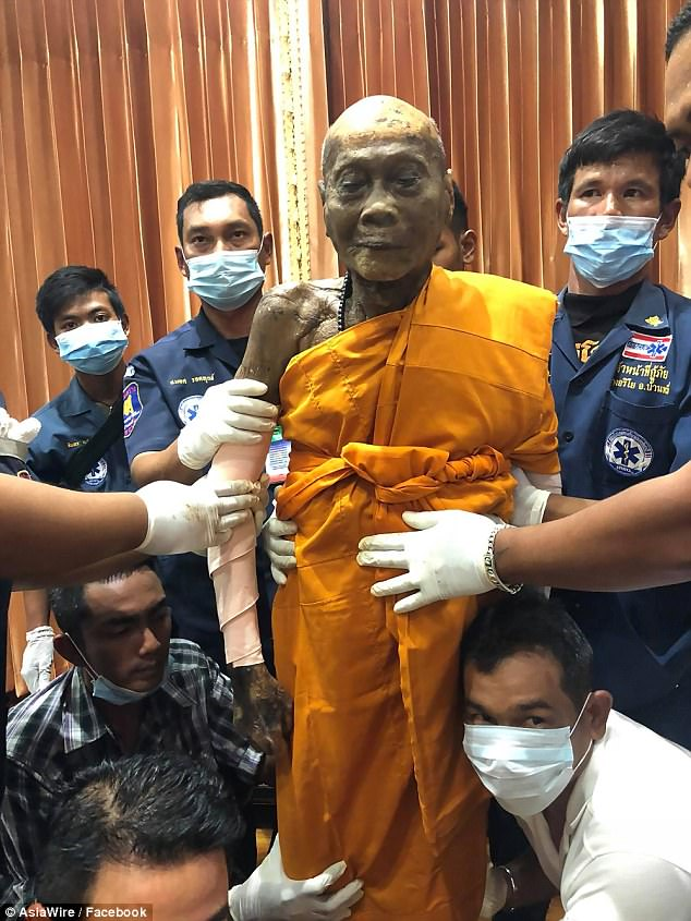 Monk Appears To Smile As His Body Is Exhumed Two Months After His Death (Photos)