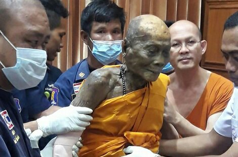 Photos: Dead Monk Smiles As His Body Is Exhumed 2 Months After Being Buried