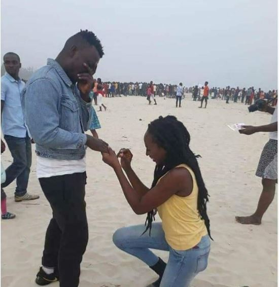 Lady Kneels Down To Propose To Her Man In Public While He