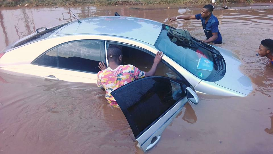 Man's Car Submerged By Flood After First Rainfall Of The Year In Benin (Photos)