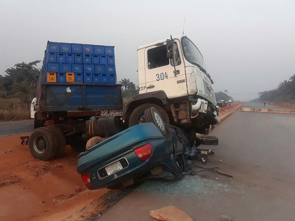 Driver Survives Horrific Accident After Trailer Crushed His Car Along Enugu-Onitsha Road. (Photos)