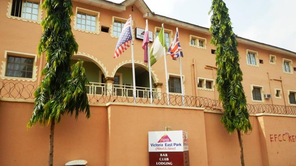 Scammer Builds Hotel In Lagos After Duping Lady With Fake Dollar Trick (Photos)