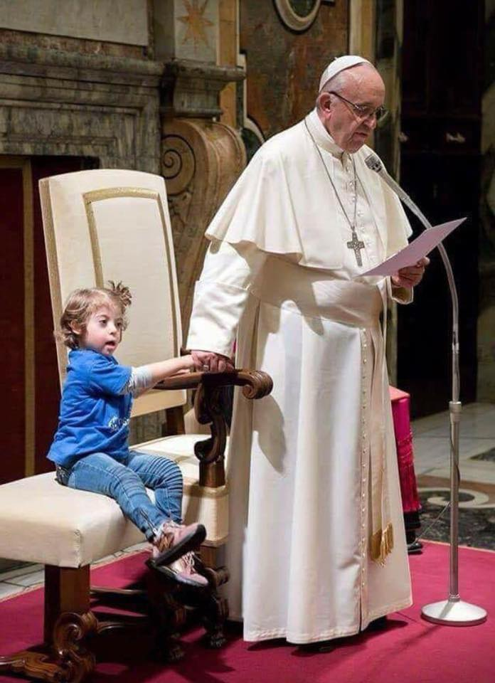 Pope Francis with a girl with down syndrome