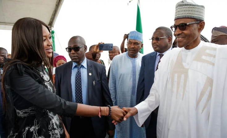 Nigerians React To Buhari's Handshake With Naomi Campbell
