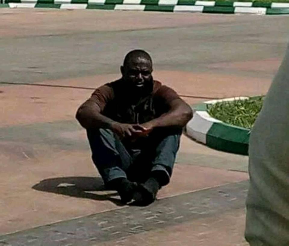 SARS Officer Who Killed Ram Seller, Paraded – Made To Sit On The Ground (Photos)