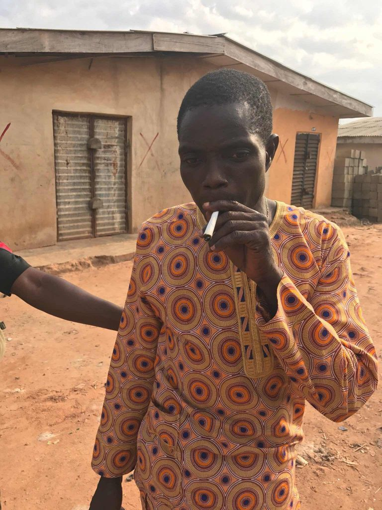 Man Continues To Smoke His Weed Even After Police Arrested Him In Lagos (photos)