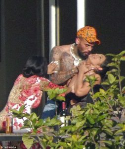 Chris Brown grips hands around woman's neck (but says it's 'playful')