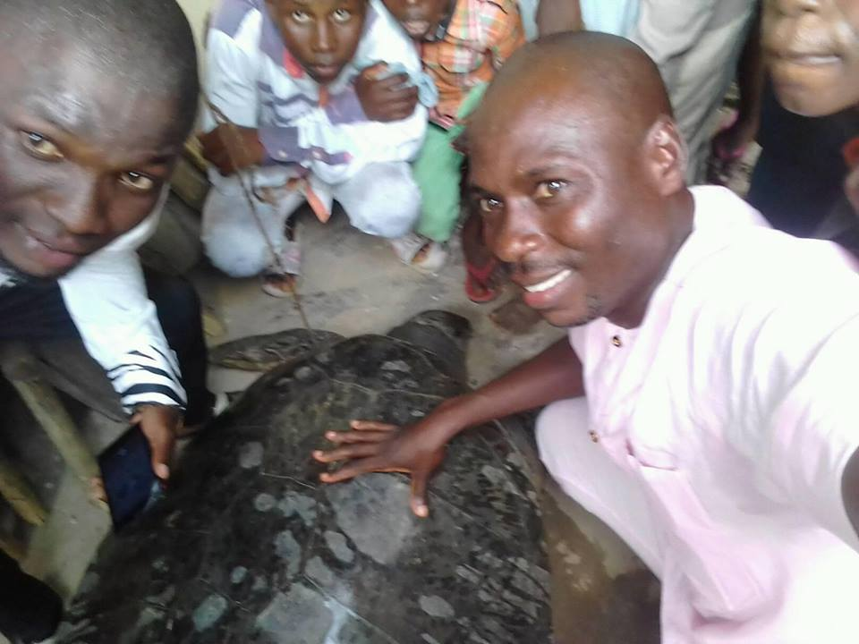 Residents Pose With Huge Turtle After Its Capture In Bayelsa State (Photos)