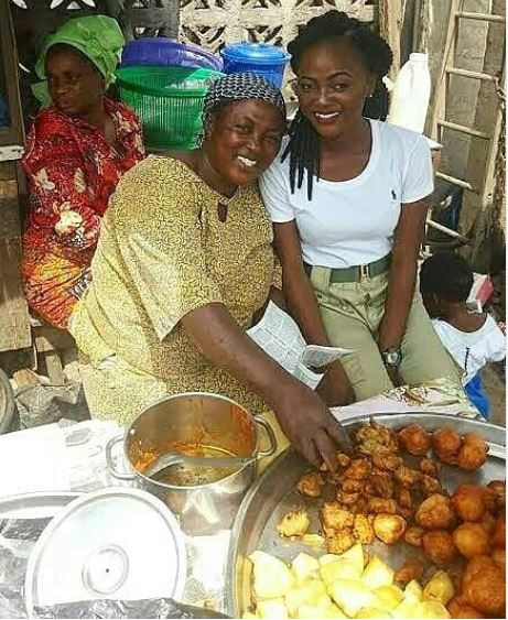 Female Corper Poses With Mum Who Sold Akara To Sponsor Her Education