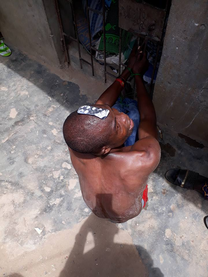 Man Tied Up While Behaving Strangely Publicly After Taking Tramadol In Lagos (Photos)