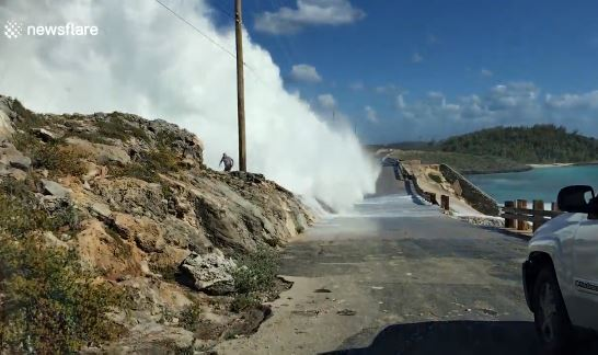 Watch The Shocking Moment A Man Was Swept Off A Bridge By Giant Waves In The Bahamas (Video)