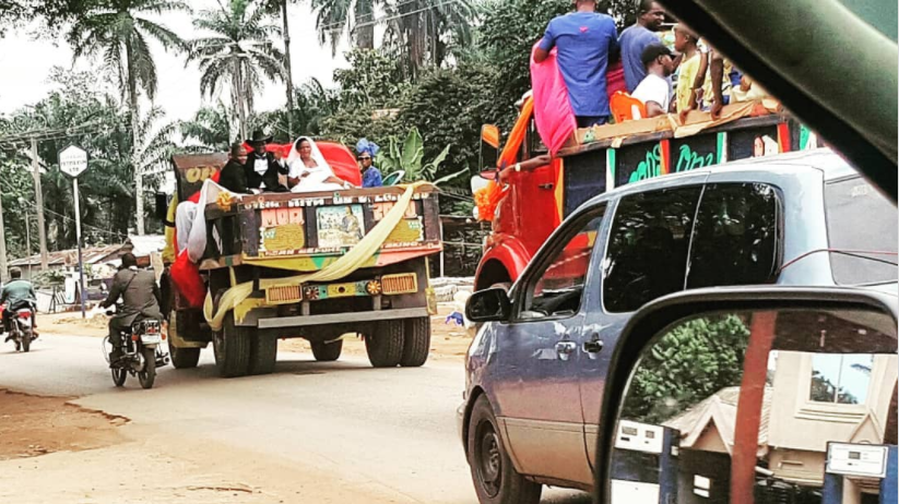 Epic Photos of Nigerian Couple Who Rode in a Decorated Lorry on Their Wedding day go Viral (Video)
