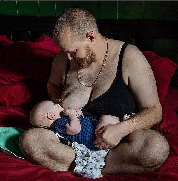 Viral Picture: Man Breastfeeding A Child