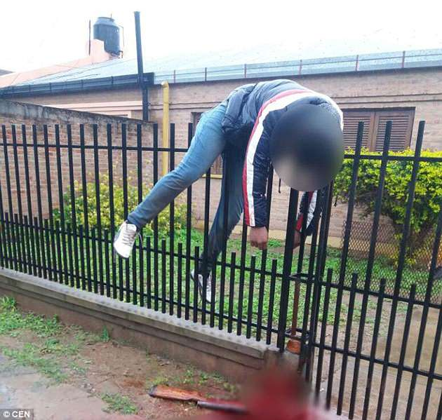 Gunman Accidentally Shoots Himself While Jumping Over A Fence (Photos)