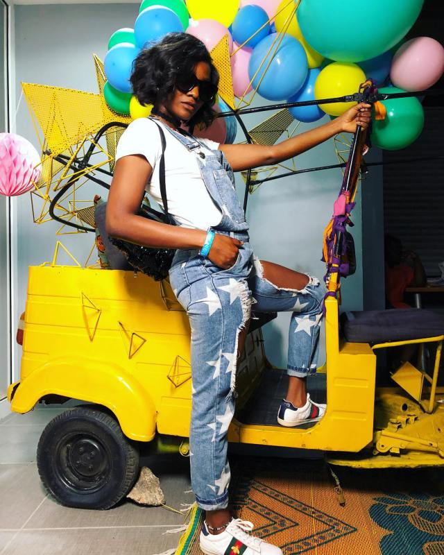 Simi Poses Like A Gangstar Inside Keke Napep in Stunning New Photos