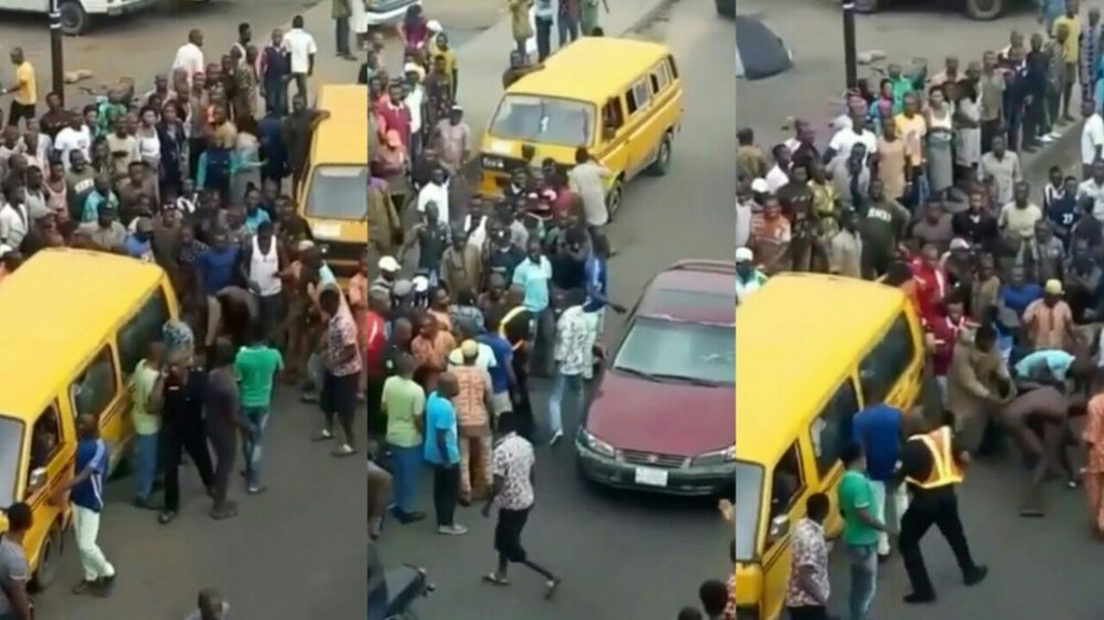 Policeman Flee For His Life As Angry Danfo Drivers Beat Him Mercilessly Over N100 Bribe (Video)