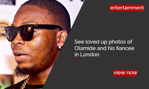 olamide and fiancee photos in London slide