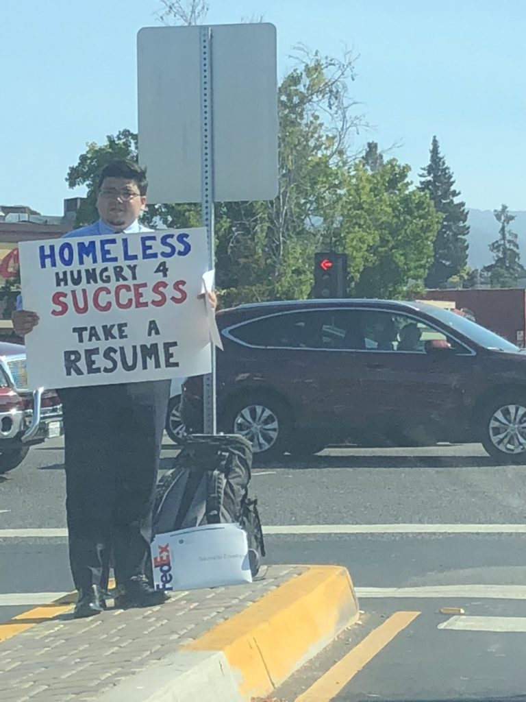 Homeless Man Gets Multiple Job Offers after Photo of him Handing out his Résumè on a Highway Went Viral
