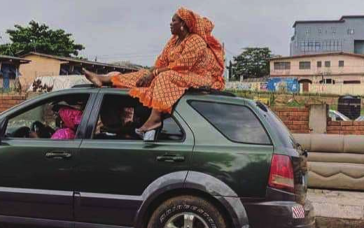 A Mobile SUV With A Woman On Top Of It Spotted On The Road (Photo)
