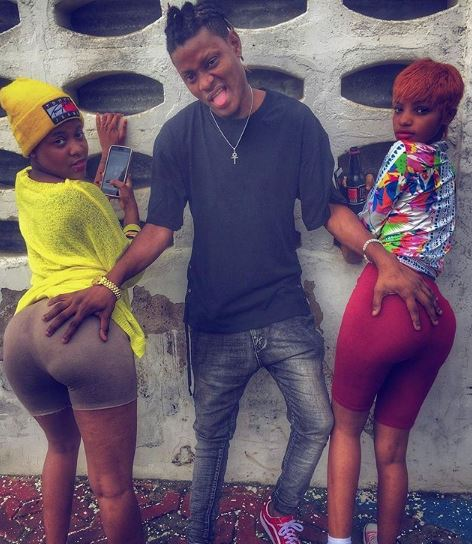 Man Goes Viral As He Shares Photo Of Himself Grabbing Butt Of 2 Ladies (Photos)