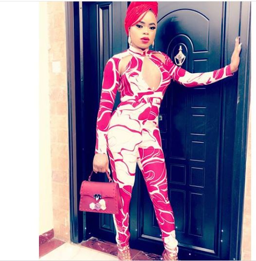 Bobrisky Steps Out Looking Peng in Jumpsuit and Female Handbag (Photos)