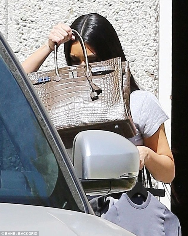 Kim Kardashian Covers Her Face With $100K Birkin Bag From Photographers Shortly After Kanye's Rant