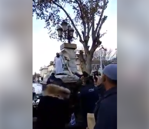 Muslim Refugee Climbs On Statue On Virgin Mary, Tries To Damage It