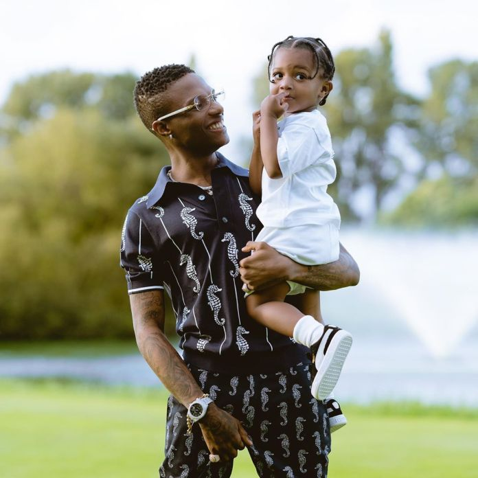 Wizkid flaunts his timeout with his son