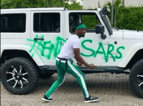 SEE how Rudeboy paints his Mercedes  Jeep with #EndSARS (Video)